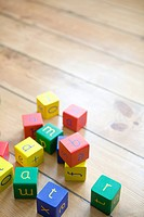Building blocks on wooden floor