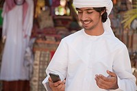 Middle Eastern man looking at mobile phone
