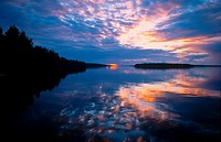 Red and blue sunset on Lake Unari, Lapland, Finland