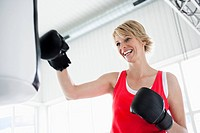 Woman boxing punching bag