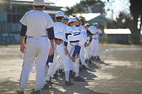 Boys in baseball uniform lined up