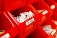 Red boxes for keeping needles in a hospital