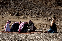 Photograph of Beduin men in the Jordanian desert
