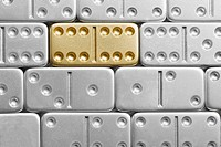 Gold domino amid silver dominoes (thumbnail)