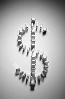 Dollar sign made of silver dominoes