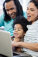Young family using a laptop