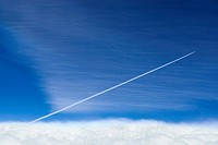 Contrail following a jet plane
