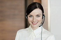 Businesswoman wearing telephone headset