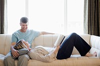 Couple relaxing on sofa (thumbnail)
