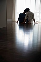 Couple sitting in new home (thumbnail)