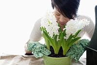 Woman smelling flowers (thumbnail)