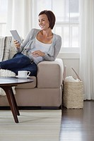 Woman using ebook reader