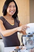 Young woman mixing some batter
