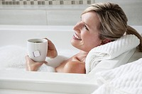 Woman drinking tea in the bath