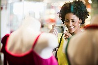 Woman shopping for dress (thumbnail)