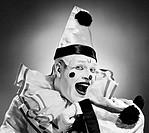 Studio portrait of clown laughing