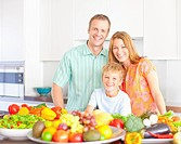 Family in kitchen with fruits and vegetables