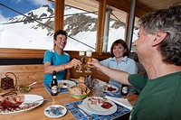 Three guests in mountain lodge Corno Gries, Val Bedretto, Canton of Ticino, Switzerland