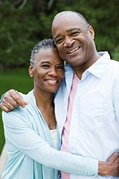 Smiling African American couple hugging