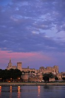 View over river Rhone to city walls, cathedral Notre_Dame_des_Doms and papal palace in the afterglow, Avignon, Vaucluse, Provence, France, Europe
