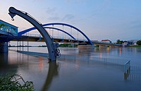 Flooded Oder with historical crane and bridge between Frankfurt at the Oder, Germany and Slubice, Poland