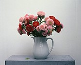Close_up of flower vase on table