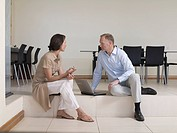 Man talking to his wife in living room