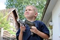 Child with a toys pistol