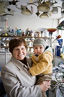 Woman with her grandchild in a small electronics shop  Zwolen Poland