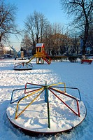 A childrens playground covered in snow, Brasov, Transylvania, Romania