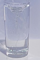 This stock image is a shot of a tall, clear, cool and refreshing glass of swirling water with lots of motion and bubbles, just inviting someone to pic...