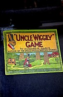 This vertical image is a display case of an antique board game called Uncle Wiggily It's aging apperance and worn look shows it's retro era fun played...