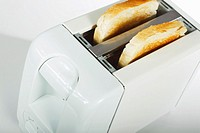 White toaster with two slices of toast  Isolated