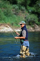 Man fly fishing the Elk river near Steamboat Springs, Colorado, USA