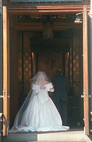Rear view of bride entering church in Brooklyn, New York