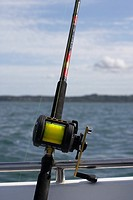 sea fishing on a boat with rod and multiplier reel