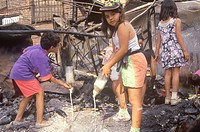 Family rummaging through home burned during riots, South Central Los Angeles, California