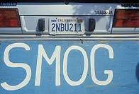 A sign that reads smog