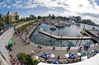 Tourists enjoying the Harbour Walkway in Victoria on Vancouver Island.