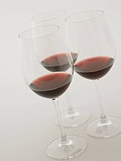 Glasses of red wine, white background