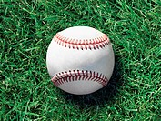 Baseball on green grass, close_up