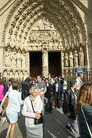 People exiting service from the Notre Dame Cathedral, Paris, France