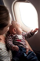 Baby with his mother on the plane