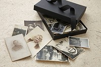 open box of vintage family photographs