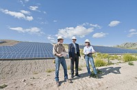 engineers and businessman in solar plant