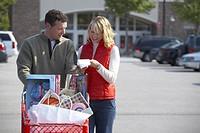 Couple Christmas Shopping checking the list