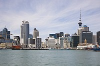 Downtown Auckland, harbor view, featuring the 328m 1,076ft high Sky Tower, the tallest building in New Zealand.