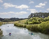 Recreational kayakers on the Puhoi River near Pahia, New Zealand