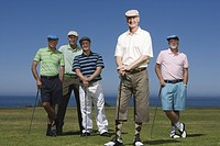 Portrait of mature men standing at golf course, smiling