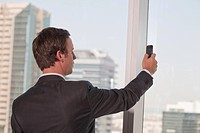 Western businessman using camera telephone